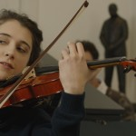 ELLIE KENDRICK (Helen) playing violin