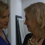 JULIET STEVENSON (Ethel) and SHARON MORGAN (Sara) meet in the bathroom door