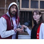 ALEX LANIPEKUN (Llion) and LYDIA WILSON (Vida) caring for pigeons