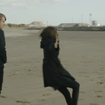 LYDIA WILSON (Vida) and JOHNNY FLYNN (Arthur) eating sand